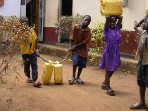 56c - It was hard work collecting water from the borehole