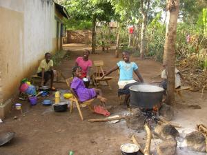 60 - Porridge on the cooking fire - Mr James tries to give every child a meal each day.