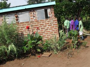 32 - The children lining up at their new latrines