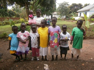 The younger girls say thank you for their new clothes