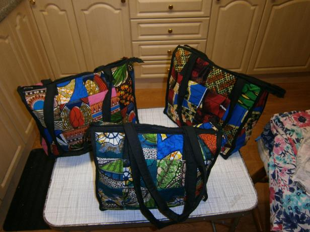 Large patchwork 'shopper', beautifully made with inside pocket and zip fastener. Suggested donation to St James in Uganda £15