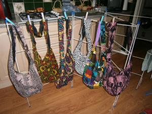 Shoulder bags fully lined, inside pocket, zip fastening. Suggested donation to St James, Uganda 8.00