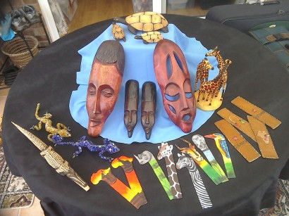 African masks big £5 small 2.50. Triple giraffe £8. Turtle big £4 small £2.50. Nile crocodile £4. Beautiful beaded lizard/gecko £8. Bookmarks £1.50
