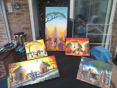 Village paintings. Suggested donation dependingn on size and or detail. Bike scene £20, smaller children playing £18, taller one £18, Acrylic painting £10
