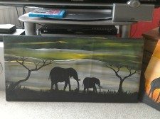 Two elephants, grey background