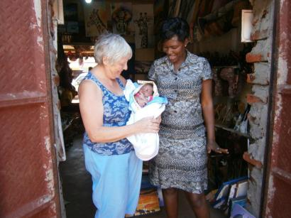 Mum Esther with her baby Azra. Esther has a sewing machine in her shop and makes many of the cloth items I bring home to raise money for St James and other other work in Uganda