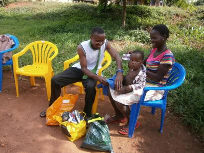 Smiles say it all! Mum Jennifer and Dad John Baptist were so excited with the new clothes