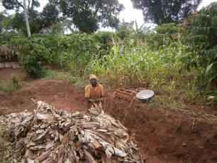 The bricks are left to partially dry under banana fronds then baked in a home made kiln