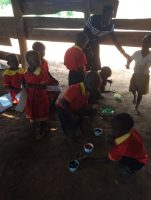 Hand printing is a new experience for these children