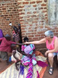 my hand is shaken a lot her in Uganda