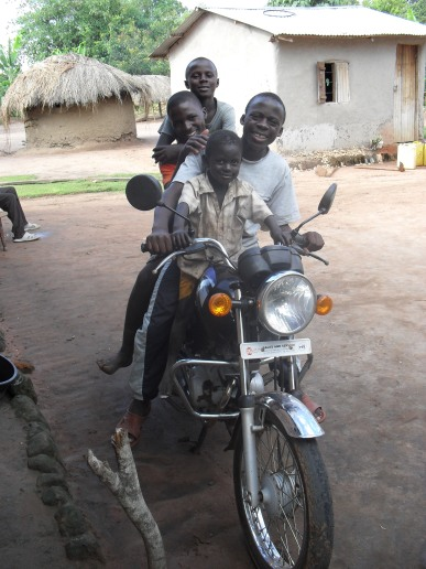 One of my favourites - Emma, Bosco, Ivan and Paul at the back on their brother Alex's motorbike in the village