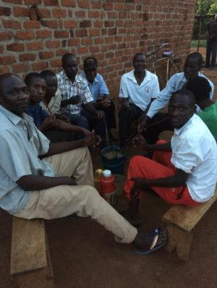 It was getting dark by the time we finished the first day of delivering and the men in the village were sat in groups supping the local brew