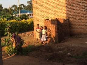 These children watched me mix paints probably wondering what fun they were going to have at school the next day with Madam Gerry! They are stood beside the family latrine & bathroom