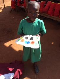 Probably the first time this little girl has used paints