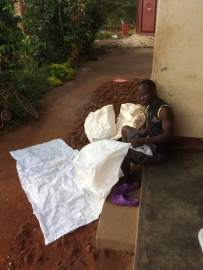 My wonderful friend Innocent is making me ground sheets out of the strong bags the mosquito nets arrived in! Brilliant! Still after a bigger ground sheet though xxx
