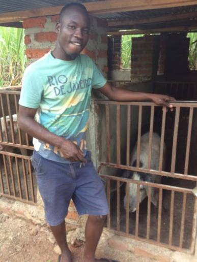 Pig farmer and my Project Manager Innocent!