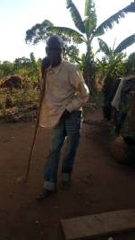Moses posing at the site of his new home wearing the jeans Amasa gave him, as he had no trousers!