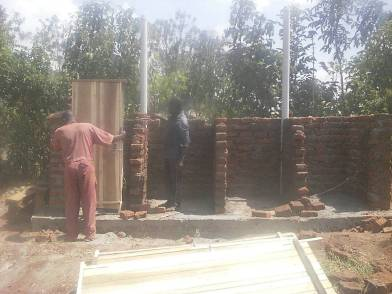 Doors going on Girls latrine block!