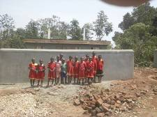 The girls outside the brand new GIRLS latrine block. The girls had never had a toilet before!