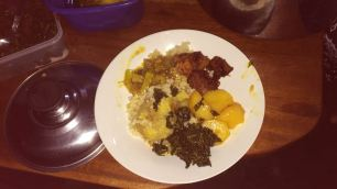 My plate - rice, matoke, roast 'Irish', dodo (poor man's spinach), g-nut source and pork done the Ugandan way - overcooked and delicious!)