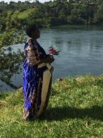 5 Mum Monica looking over the Nile holding he bouquet. She is to walk Alex down the isle.