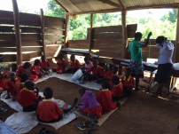 Working in the rough wood classrooms. Note the teachers busy making necklaces too!