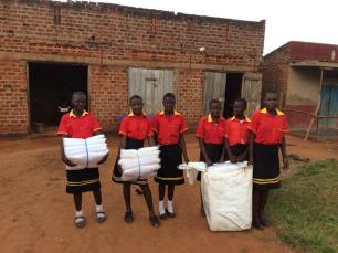 All these teenagers and their friends in the Primary 7 class were given mosquito nets by Lower Park Primary School