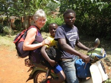When I'm in Uganda I try to spend time with each of the students. Here I am taking Paul out for the day, using a boda, motorbike taxi!