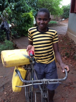 Alex with one of the Poynton Pebbles that made its way to and from Uganda!